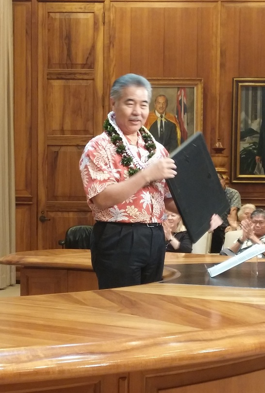Governor Ige with the Proeclamation